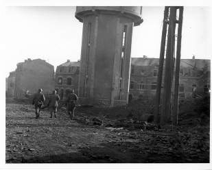 12/25/1944 - Members of the 101st Airborne Division as they Walk Past Dead Comrades.