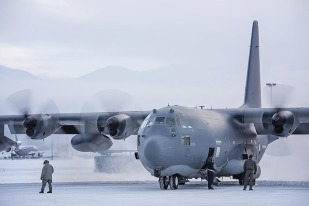 Current and former members of Alaska Air National Guard's 211th Rescue Squadron bid farewell to the last of their HC-130N King Jan. 17, 2017, as it departed for Patrick Air Force Base, Fla. The older HC-130N's are scheduled to be replaced with four new HC-130J Combat King II aircraft which are currently being manufactured at Lockheed Martin in Georgia. (U.S. Air National Guard photo/Staff Sgt. Edward Eagerton)